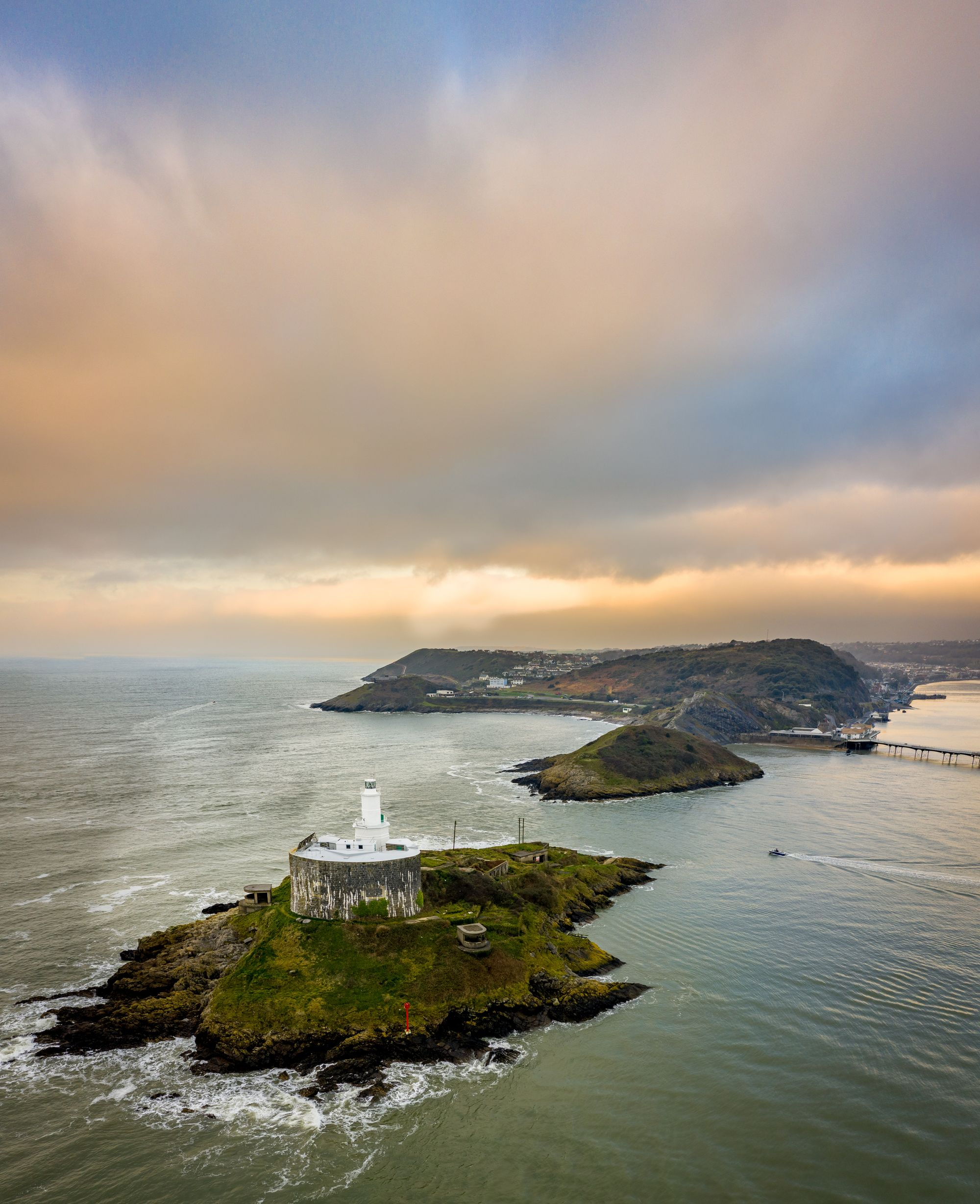 Arial view of a Offshore island with lighthouse on Mumbles Head in Swansea Bay